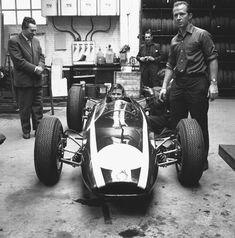 garage life … Bruce McLaren in the Cooper-Climax T66 he would use for the 1963 F1 World Championship John Cooper himself (the man in the suit) looks on with confidence