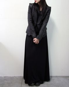 Leather jacket with sleek maxi dress. Tough Morticia Addams.