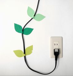 Place washi tape shaped like leaves around ugly cords and the creeping cord will become a wall decoration.