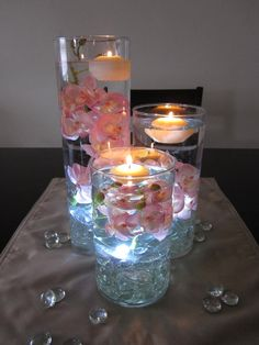 LED centerpiece idea.  It looks like she just used fake silk flowers and glass beads.
