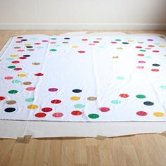 Confetti Tablecloth DIY {Tablecloths} -- black tablecloth with colorful or white polka dots (match the sprinkles and set everything off)