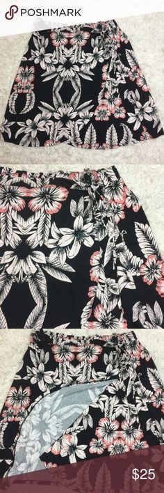 """Black Floral Wrap Skirt Plus Size 2X New This pretty skirt reminds me of Hawaii. It is knee length, Split Down the Front. Elastic waist. Tie belt, rayon and spandex. Waist unstretched measures 40"""", length 27"""". Black with gorgeous pink and white flowers. living doll Skirts Midi"""