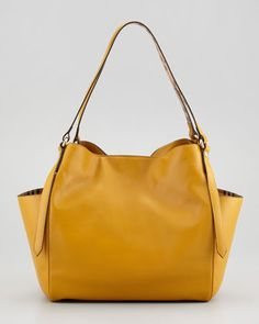 Small Leather Tote Bag with Pockets, Gold by Burberry at Neiman Marcus. $995. Soft and simple.