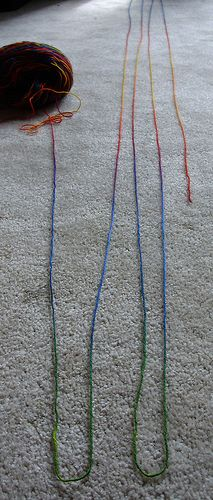 "On planned pooling: Unskein your yarn and lay it onto the floor in a zig-zag pattern, so that the colours align. Then mark the first 3-4 ""corners"". Each of those rows of yarn is one row of knitting. Cast on using a backwards loop cast-on. Turn when you reach the corner. Knit the second ""row"" and If you use up yarn before you hit the colour match from the cast-on row, switch to a smaller needle. If your colour match is moving ahead of the previous row, switch to a larger needle."