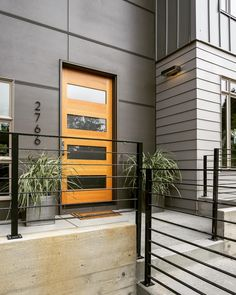 """Team JISH on Instagram: """"Make a statement with your entrance. Custom fabricated steel railings, board formed concrete, hardie panel, hardie plank, and standing seam metal. Not to mention that oversized modern door. #jordaniversonsignaturehomes"""""""