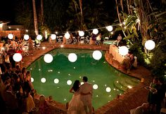 Hang lights over the pool of your reception // Ashleigh Taylor Photography