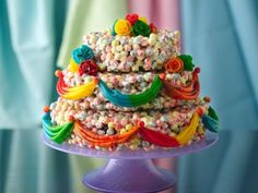 cereal cake from Cute Everything ...Trix cereal krispie treats molded in round cake pans and decorated with fruit roll-ups.