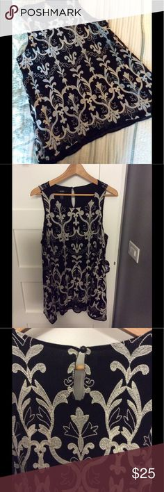 Beautiful sleeveless black/white top from Macy's Gorgeous black sleeveless blouse with white embroidery.  Top 100% nylon.  Embroidery 100% polyester.  Lining 100% nylon.  Machine wash cold.  Purchased at Macy's. Alfani Tops Tunics