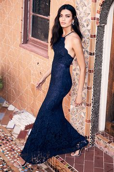 You've reached the pinnacle of high society when you have an occasion to wear the Zenith Navy Blue Lace Maxi Dress! A darted, scalloped bodice rises to form a high neckline with adjustable straps that crisscross at back. Grosgrain ribbon sash tops a flaring mermaid maxi skirt. Hidden back zipper and clasp.