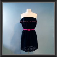 Black Ruffle strapless dress Adorable black strapless dress with a ruffle on the top. Has a neon pink trim and belt. Worn only a couple times. In excellent used condition. Please ask all questions before purchasing. ✅ reasonable offers  no trades  offline transactions. Thanks for stopping by!  Snap Dresses Strapless