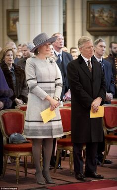 Queen Mathilde is seen standing alongside her husband King Philippe at the service, held i...