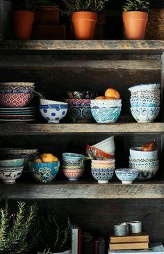 beautiful cups in a wooden shelf