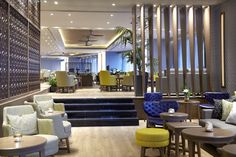 Wyndham Grand Athens hotel welcomes you, fully renovated, to a new haven of affordable luxury in the center of Athens. Conveniently located right next to Metaxourgeio metro station Wyndham Grand Athens is the ideal starting point to explore Athens. Athens Hotel, Relax, Lounge, Bar, Silk, Luxury, Table, Furniture, Home Decor