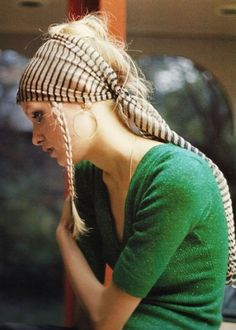"More Boho than Cowgirl but I still love it.  Love how she's got the braid hanging out in the front.  Could ""Cowgirl"" it up a bit by using a long bandanna instead of the stripes.  (Just sew several bandannas together end to end)"