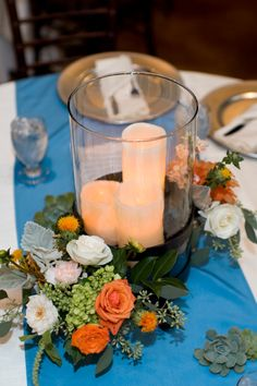 orange & teal wedding | centerpiece | The Moss & Rose | candles | hurricane | succulents roses