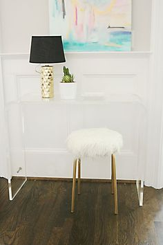 Got 10 minutes? Make this DIY Ikea Hack white fur stool in no time and you'll be adding instant glam to a bathroom or bedroom or a corner of your house.