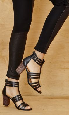 Genuine leather gladiator heels with a caged silhouette, ultra-walkable stacked heel, open toe, side buckles and easy back zipper.