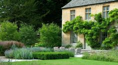Cotswold garden designed by Dan Pearson, dry stone walling, stone paving, pool, pond