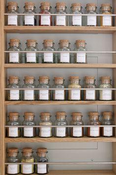 spice rack with labelled jars neatly displayed in a row Spice Storage, Jar Storage, Glass Storage Jars, Spice Racks, Kitchen Jars, Kitchen Pantry, Kitchen Storage Jars, Home Organisation, Pantry Organization
