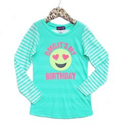 OMG, Its My Birthday!!! Celebrate with this emoji birthday design made from beautiful yellow and pink glitter on a super stylish, stripe, mint green,long sleeve tee. Makes the perfect foundation piece for your tween birthday girls outfit. All artwork and designs are copyright of M.A.D.Grrl. Sizes: 3, 4, 5/6, 6X, Small 7/8, Medium 10, Large 12/14, X-Large 16
