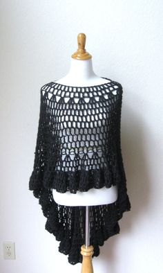 black poncho, weary treaded woman to wear, old and battered