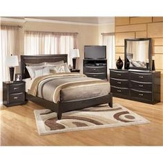 kasidon queen upholstered bed in dark gray with arched