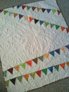A Few Scraps: Accuquilt: Bunting Quilt Tutorial  (use old baby clothes)