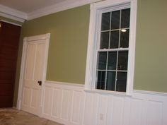 Old 5 panel doors turned on their side and used as wainscoting ....turned out great!