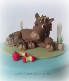 Sugar modelled horse cake topper.