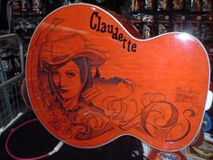 Jack White acoustic. Cool idea - wood burning designs into guitar.  http://www.feelnumb.com