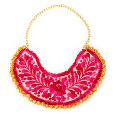 The charm of this colorful hand embroidered bib necklace made in Oaxaca City, Mexico is how it harmoniously blends traditional and contemporary styles. The idea behind this artful piece, designed by l