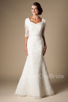 Modest Wedding Dress | LDS Bridal Gown | LatterDayBride & Prom | SLC | Utah | Worldwide Shipping | 2017 Collection | Jacqueline | This darling lace gown features a soft sweetheart neckline, beautiful lace sleeves, a flattering floral and beaded waistband and lovely scalloped lace. Gown available in Ivory/Silver or White/Silver *Gown pictured in Ivory/Silver Neckline and sleeve length can be customized.