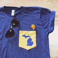 Roll up your sleeves and keep #Michigan close to heart.  Link in bio! #mondaymotivation #summertime #pockettee #details #maizeandblue #printedbyUGP
