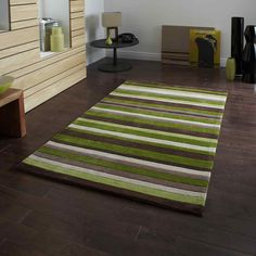 The Hong Kong rug in Green and Brown is handmade in China and offers a luxurious, deep, soft 100% Acrylic pile. This striped rug is easy to clean and colourfast. #Rugs #Rug