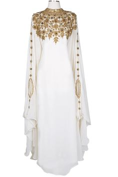 The Athena Kaftan is a Covered Bliss top-pick and BEST SELLER.   Extraordinary goldenembellishments across the shouldersand along the sleeves.  Hidden waist strapinside adds flexibility in adjusting the desired fitting.Whether you like it form fitting or loose, this kaftan will create a perfect look for any occasion.  Elegant crystal decor helps this piece sparkle and stand out.  This kaftan is hand made and customized to provide the perfect look for you.