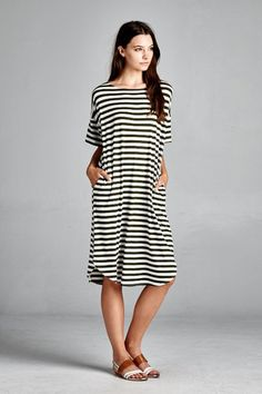 This midi-dress with pockets is simple enough to be worn multiple ways. Mix it up with leggings and boot or a cardigan and heels.