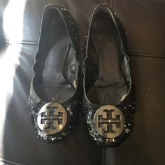 Used Tory burch flats Very used. And some rips and tears, with sequins missing. But they still have loads of life left in them and super cute. I believe they are a size 7, but may be 7.5 can't find the size on the shoe. 100% authentic. I always get compliments on these Tory Burch Shoes Flats & Loafers