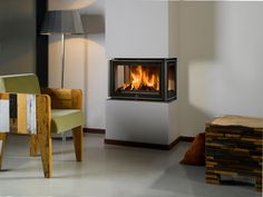 Unilux 300, met driezijdig glasvlak: mooie inzet houthaard van Barbas.