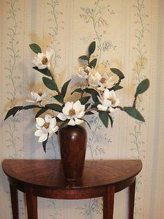 Paula Gilhooley - flower arrangement; Robert DePriest - turned wood vase
