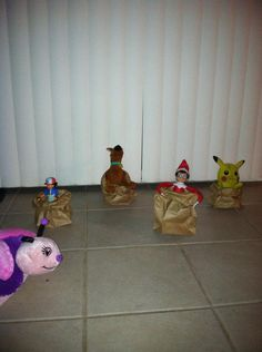 Sammy his having a Paper sack race with his buddies