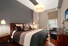 140 West 22nd Street, Apt. 2F   Chelsea, Manhattan    ผนังห้องนอนชายหนุ่มโทนสีเทาแบบนี้ ให้ความรู้สึกนุ่มลึก เรียบๆ แต่ดูโก้เก๋ไม่เบา เหมาะกับหน่มนักธุรกิจ หรือคอนโดย่านธุรกิจ ท่านสามารถเลือกเฉดสีที่ใกล้เคียงกันนี้ได้จากเครื่องผสมสี เบอร์เจอร์ คัลเลอร์โซน #8232 - Girgitta พบกับผลิตภัณฑ์สีทาบ้านเกรดพรีเมี่ยม และเฉดสีนับพันตรงใจคุณได้ที่บูธ Berger Colourzone ที่ห้างโกลบอล เฮ้าส์, ไทวัสดุ, และดูโฮม ทุกสาขา รับประความพึงพอใจ
