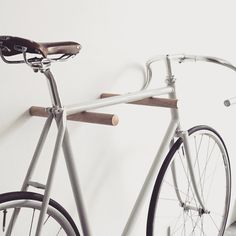 These minimal wooden bike hooks present an elegant and clever way to store your bespoke bicycle at home. Conceived as a piece of high-quality furniture rather than a mere practical device they offer an extremely simple but sophisticated storage solution for light sports bikes. Meticulously