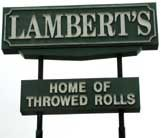 Don't go to Branson, Missouri, without stopping by Lambert's in Ozark.  Lambert's is home of the throwed rolls - If you want one you wave and they throw one across the restaurant to you.  Lambert's is also known for their pass arounds (pan fries, okra, black-eyed peas, and macaroni and tomatoes) brought to the table constantly through the meal.