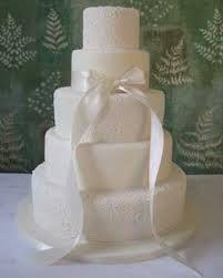 plain white ribbon cake wedding