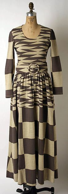 Dress by Rudi Gernreich, 1971: Rubi Gernreich was known for his designs that attempted to create an androgynous look for both men and women. This dress shows a graphic, geometric print on a printed dress.
