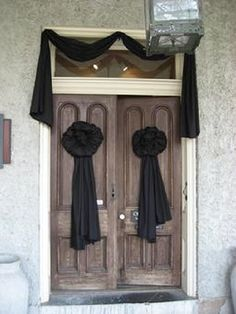 Draped in black - A sign that a Victorian family was in mourning.