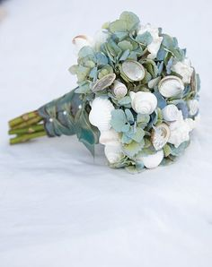 I like how this is tied. Would be nice for a beach wedding. Shell Bouquet by MDS Floral Designs