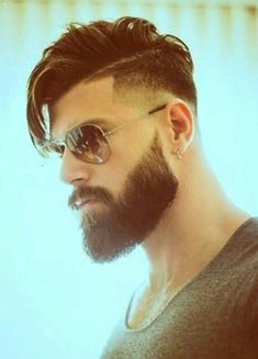 Stylish finesse is always welcome. This look just took masculinity to a completely different level. The way that beard balances his hair. The visual deliciousness is simply divine.