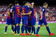 Luis Suarez (C) of FC Barcelona is congratulated by his teammates after scoring the opening goal during the Joan Gamper trophy match between FC Barcelona and UC Sampdoria at Camp Nou on August 10, 2016 in Barcelona, Catalonia.