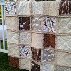 Cozy soft crib size rag quilt done in 100% cotton fabrics in combination with tan minky featuring designer prints. It would make a great gift or